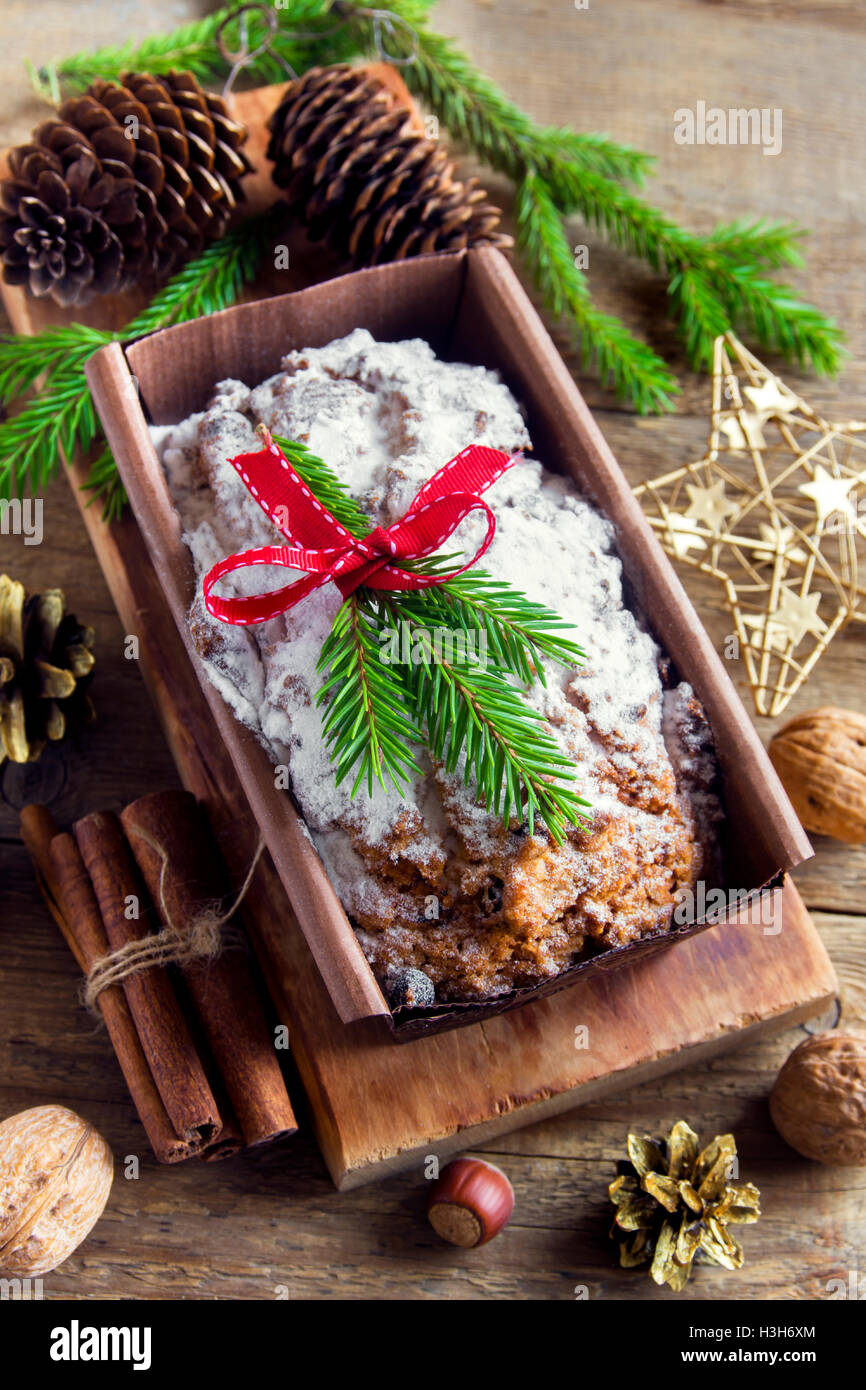 Traditional fruitcake for Christmas with decoration and ornaments - homemade festive Christmas pasrty - Stock Image