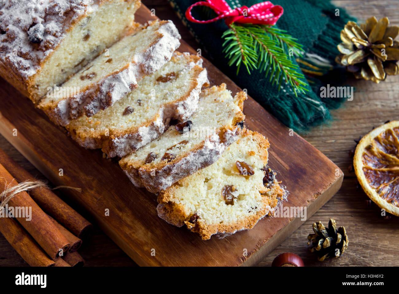 Christmas festive fruit bread (cake) on rustic wooden board - homemade Christmas bakery - Stock Image