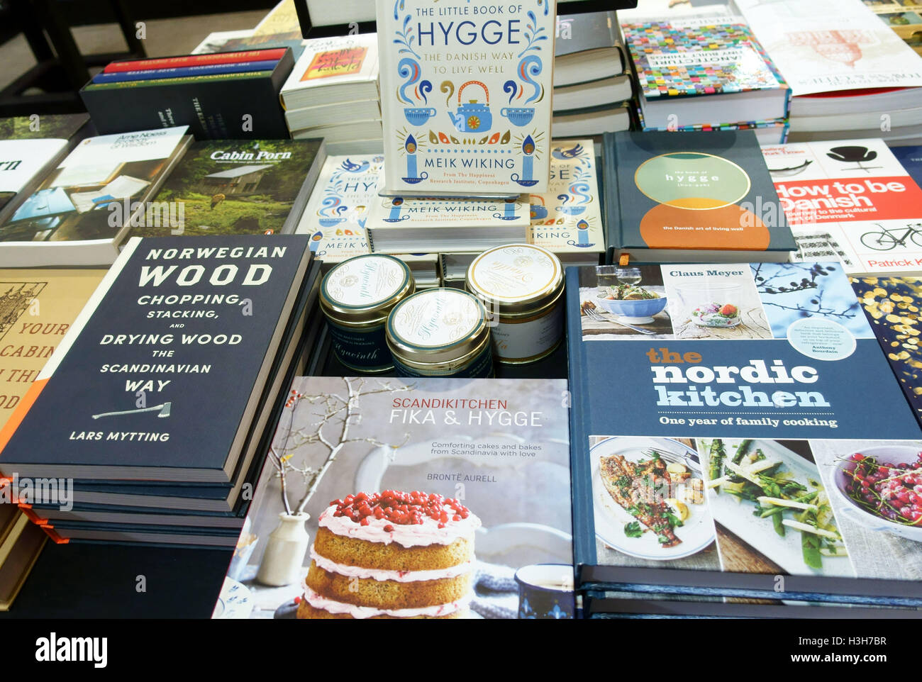 Bookshop display of books on the Danish art of Hygge, London - Stock Image
