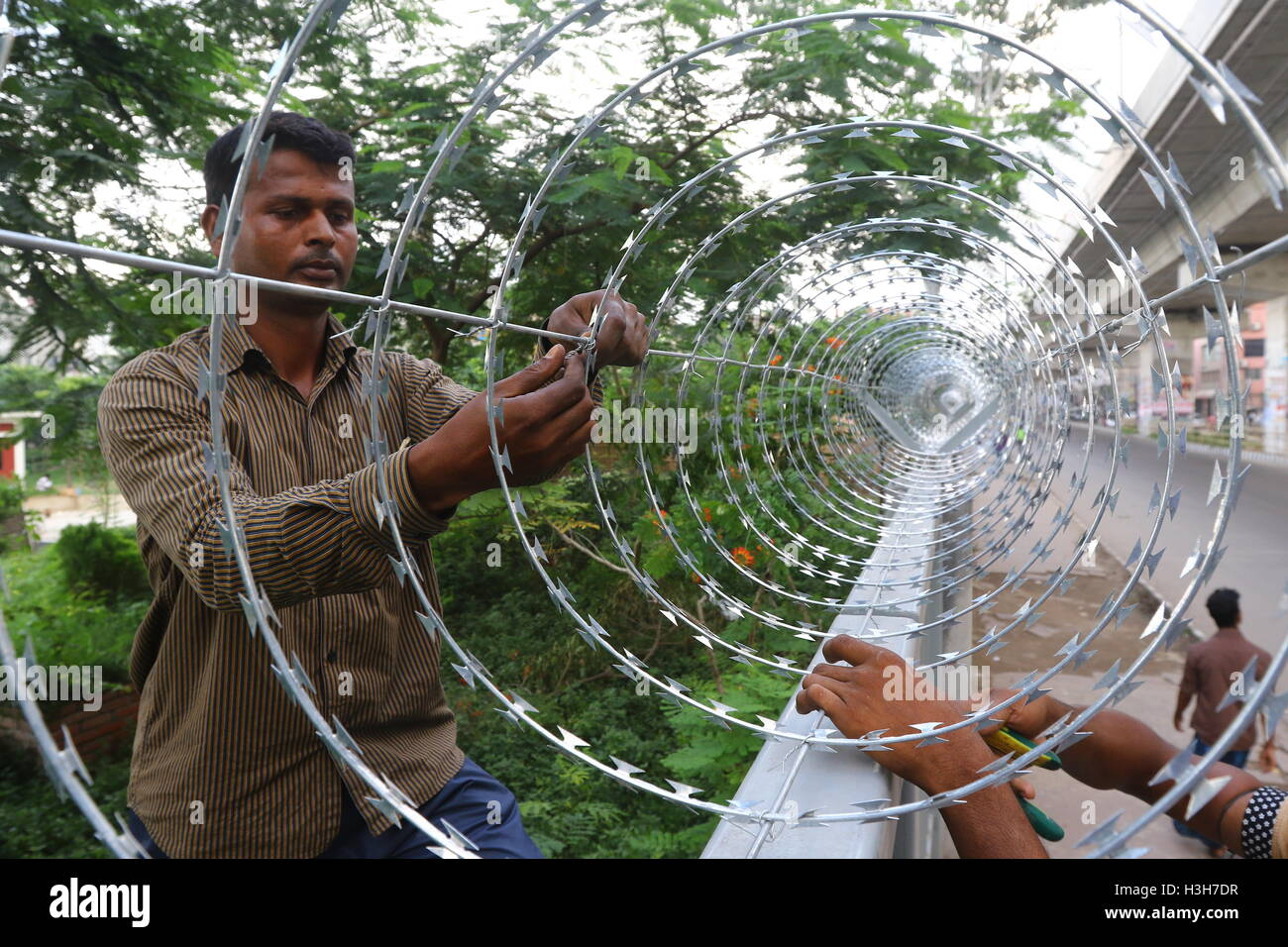 Secured with razor wire on top of the iron fence . - Stock Image