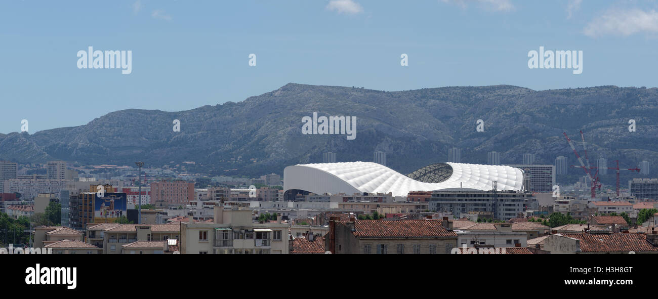 Olympique de Marseille stadium Stade Velodrome in Marseille, panorama with mountains in the background. - Stock Image