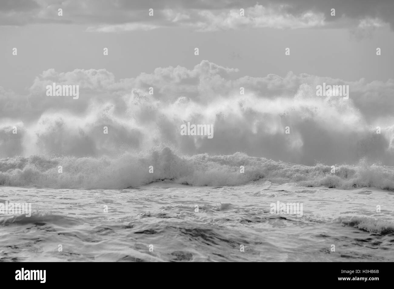 Ocean waves crashing exploding water power from weather storms, - Stock Image