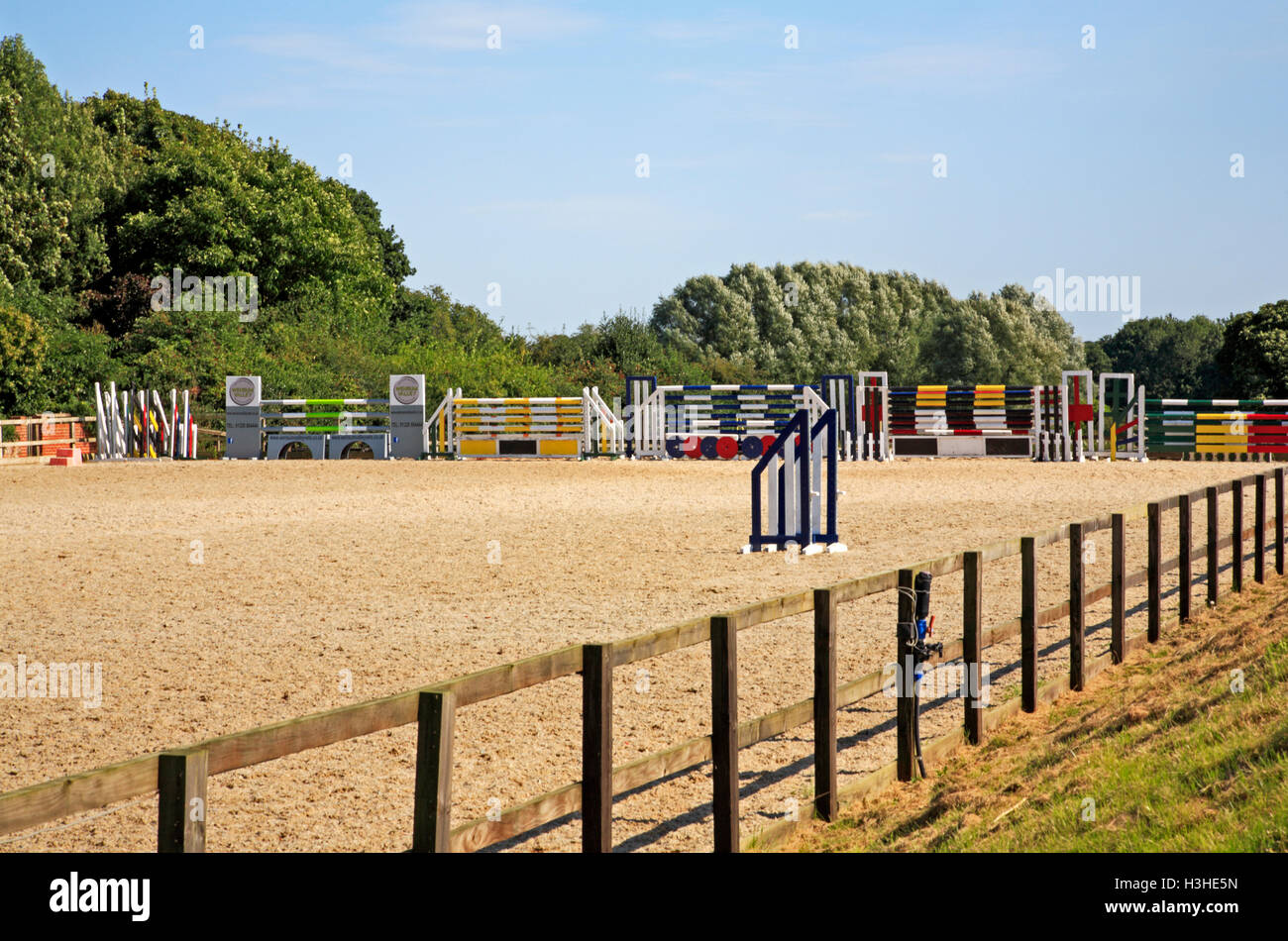 An arena with stored fences and poles for equestrian eventing at Brampton, Norfolk, England, United Kingdom. - Stock Image