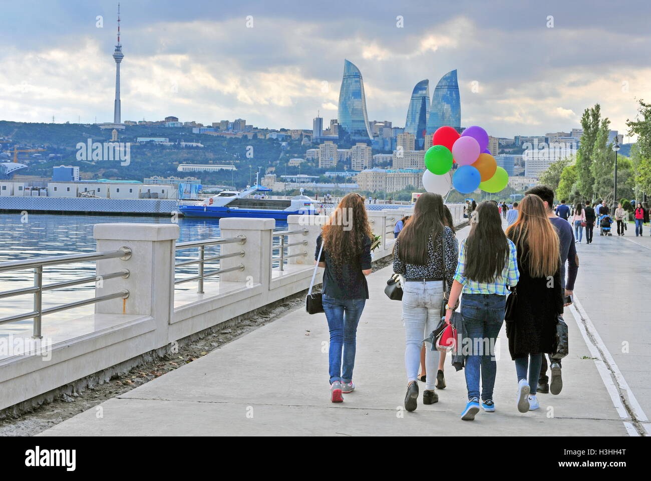 BAKU, AZERBAIJAN - SEPTEMBER 25: People goes by the seafront of Baku on September 25, 2016. Baku is a capital and - Stock Image