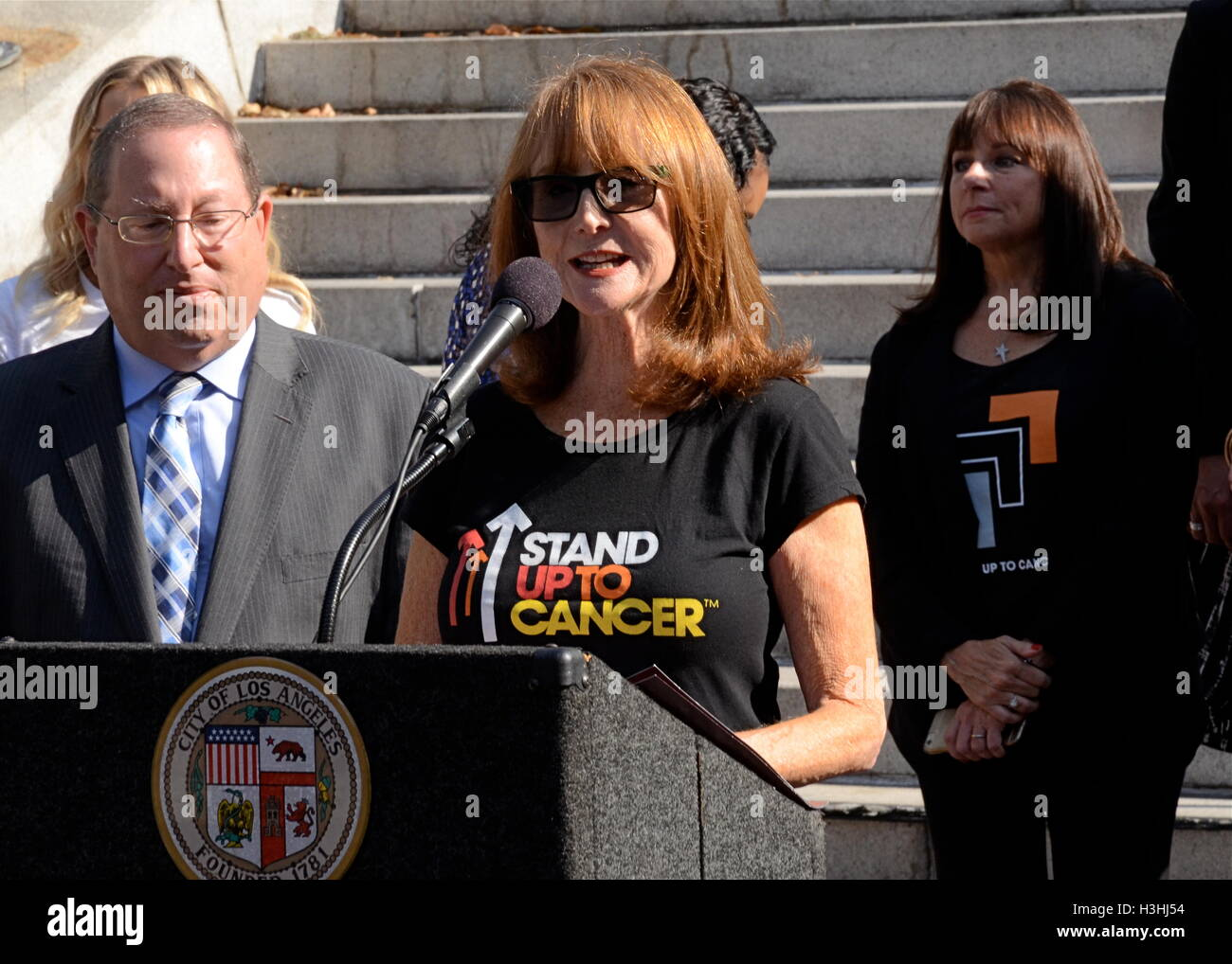 Paul Koretz and Marg Helgenberger attends Press Conference For 'Stand Up To Cancer Day' at Los Angeles City - Stock Image