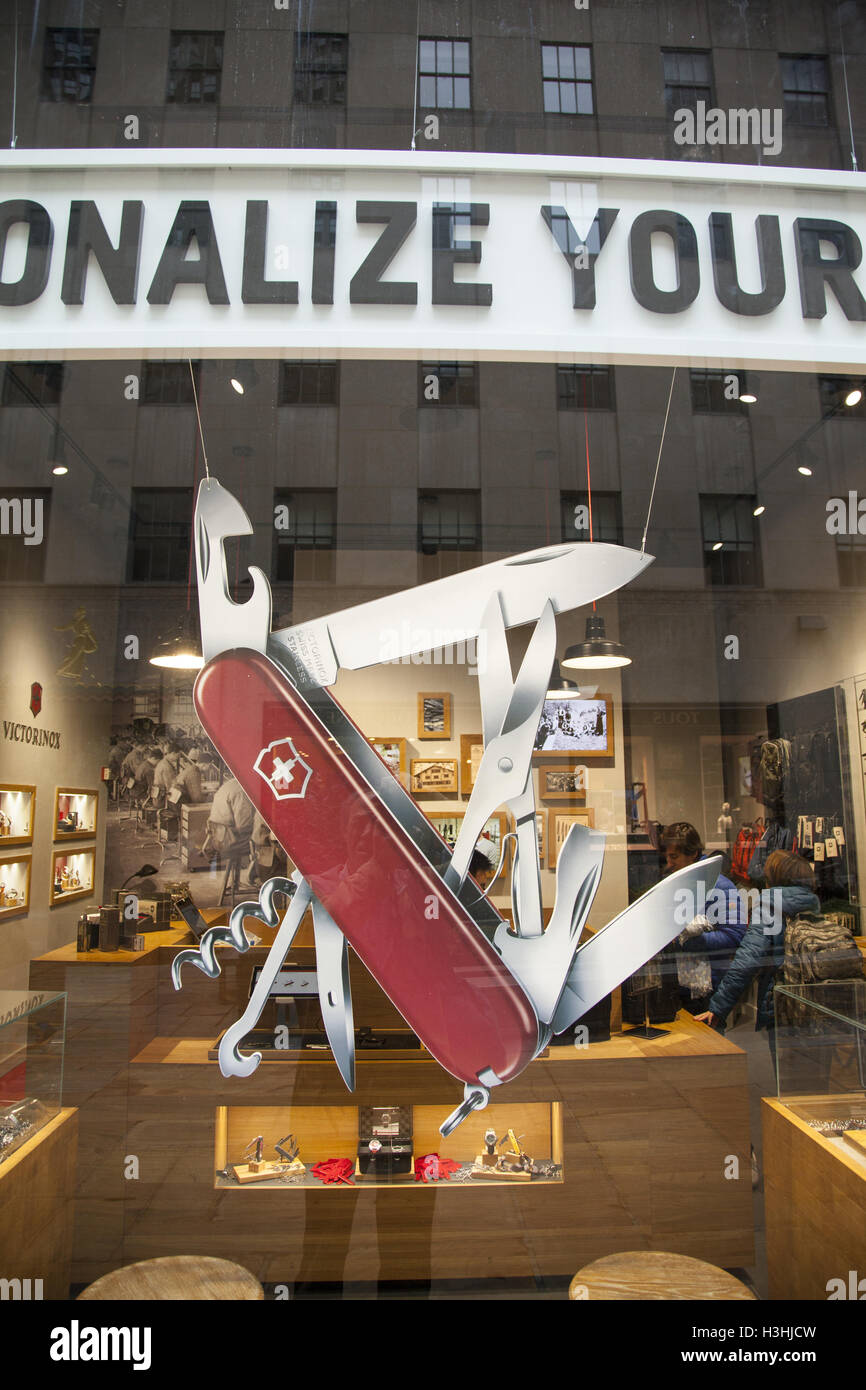 Store in Rockefeller Center with a giant model of the famous 'Swiss Army Knife' in the window. - Stock Image