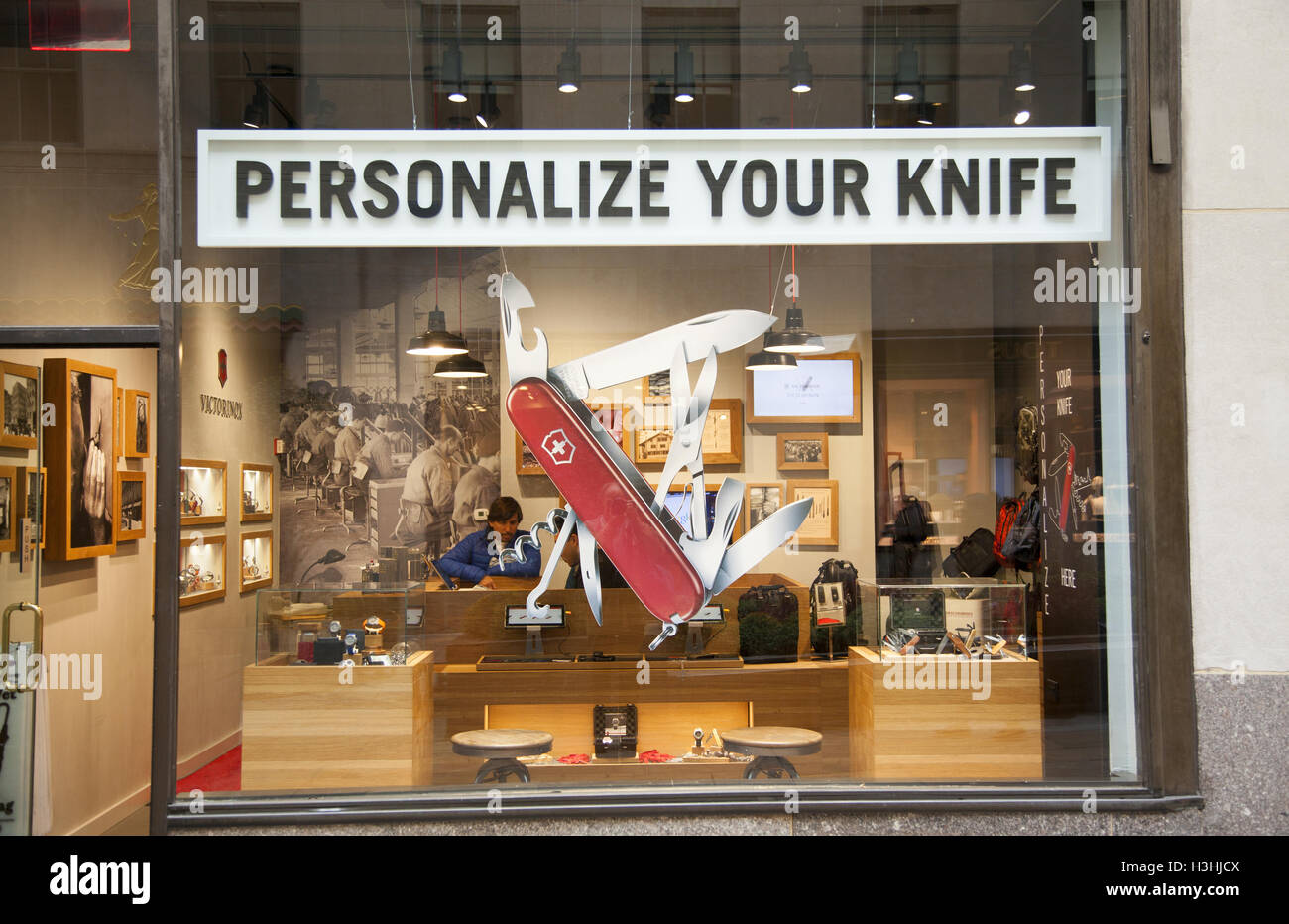 store in rockefeller center with a giant model of the famous swiss