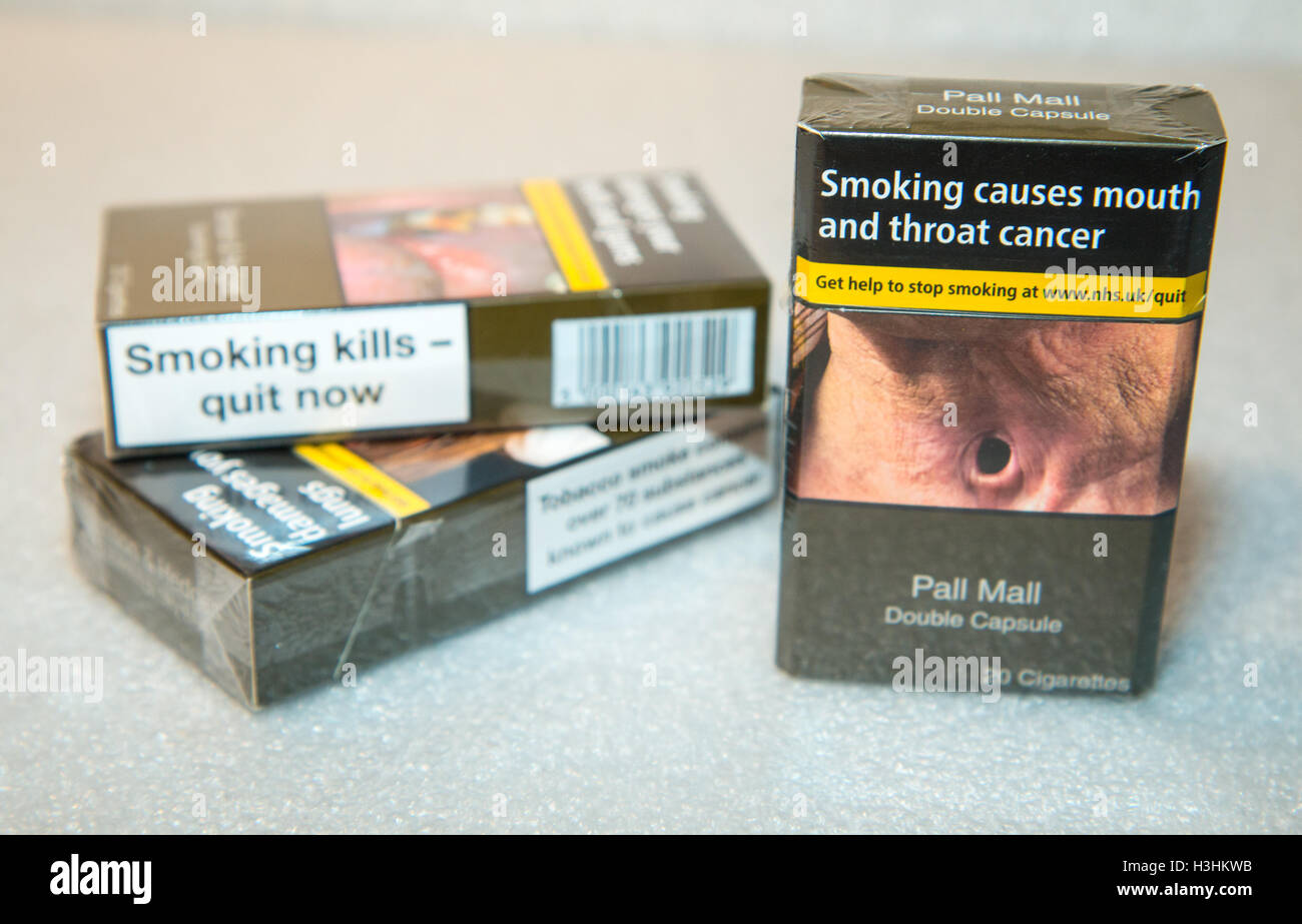 Some of the first UK standardised (plain) packs of cigarettes to appear in shops - Stock Image