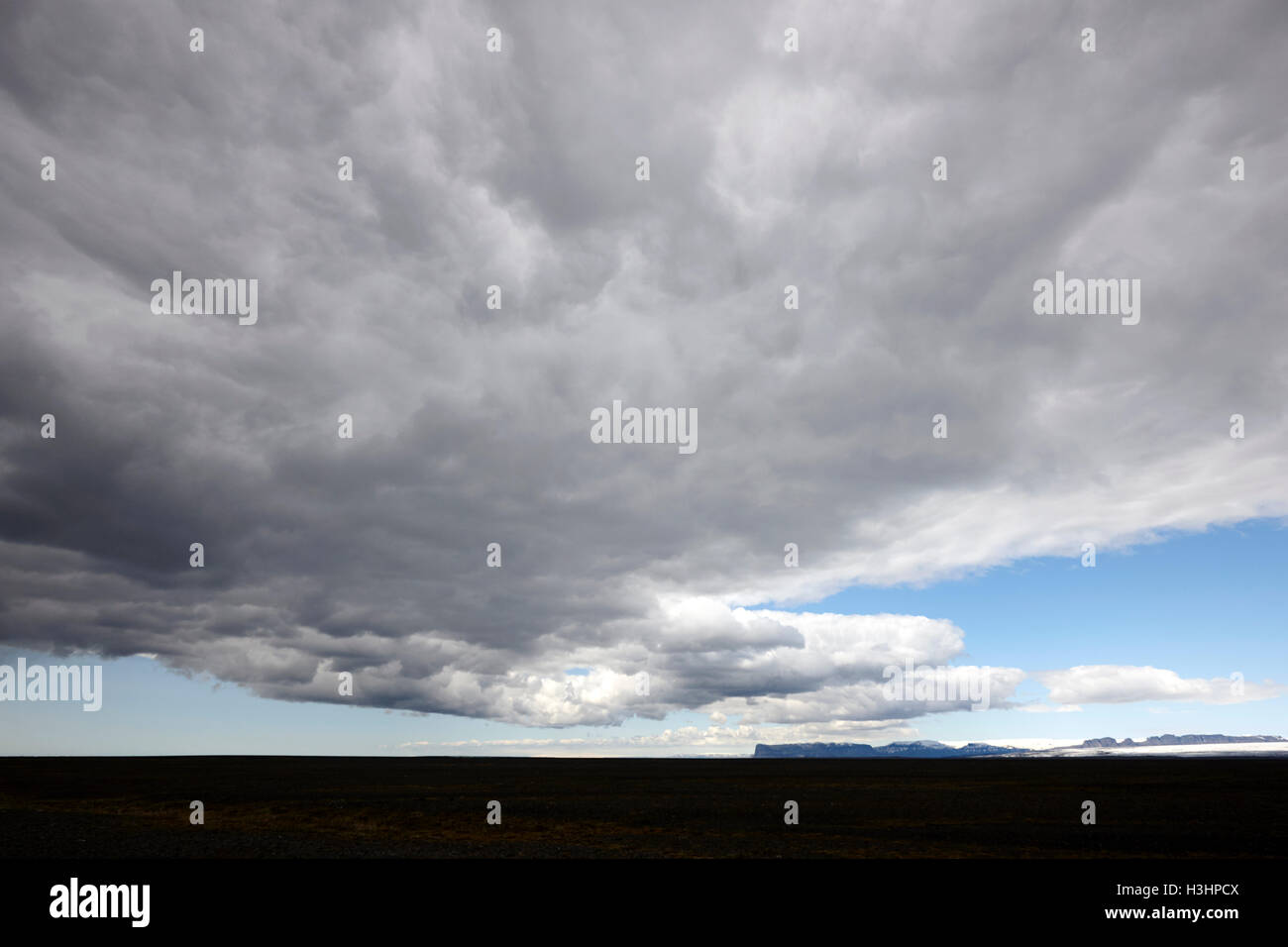 rain clouds and weather front move over ring road hringvegur across the skeidararsandur sand plain sourthern iceland Stock Photo