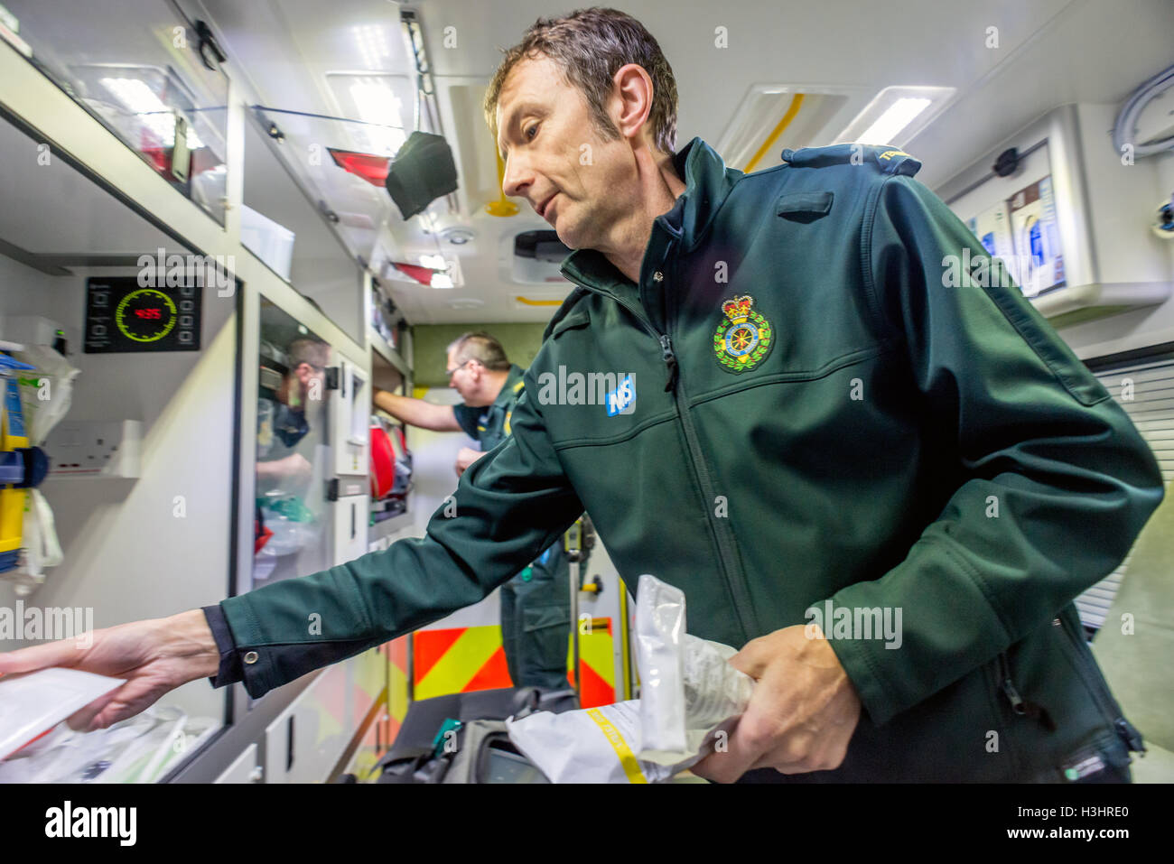 Brighton Paramedics on duty on the Friday before Christmas.   Ambulance Technician Martin Dowle checking the on - Stock Image