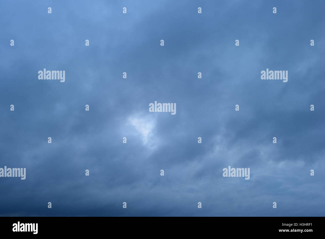 Abstract natural background of the cloudy overcast sky - Stock Image