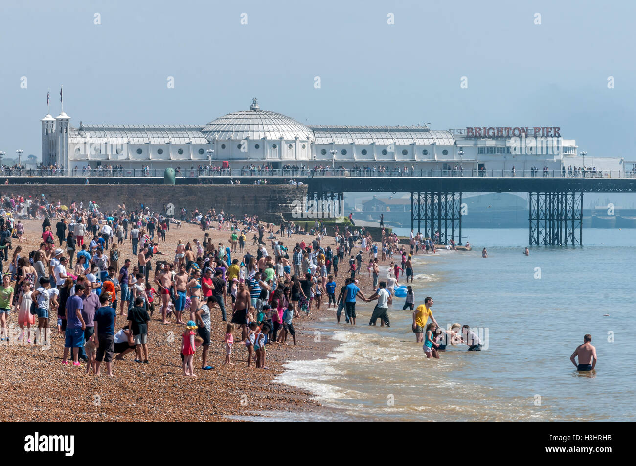 Brighton beach on a sunny spring day - Stock Image
