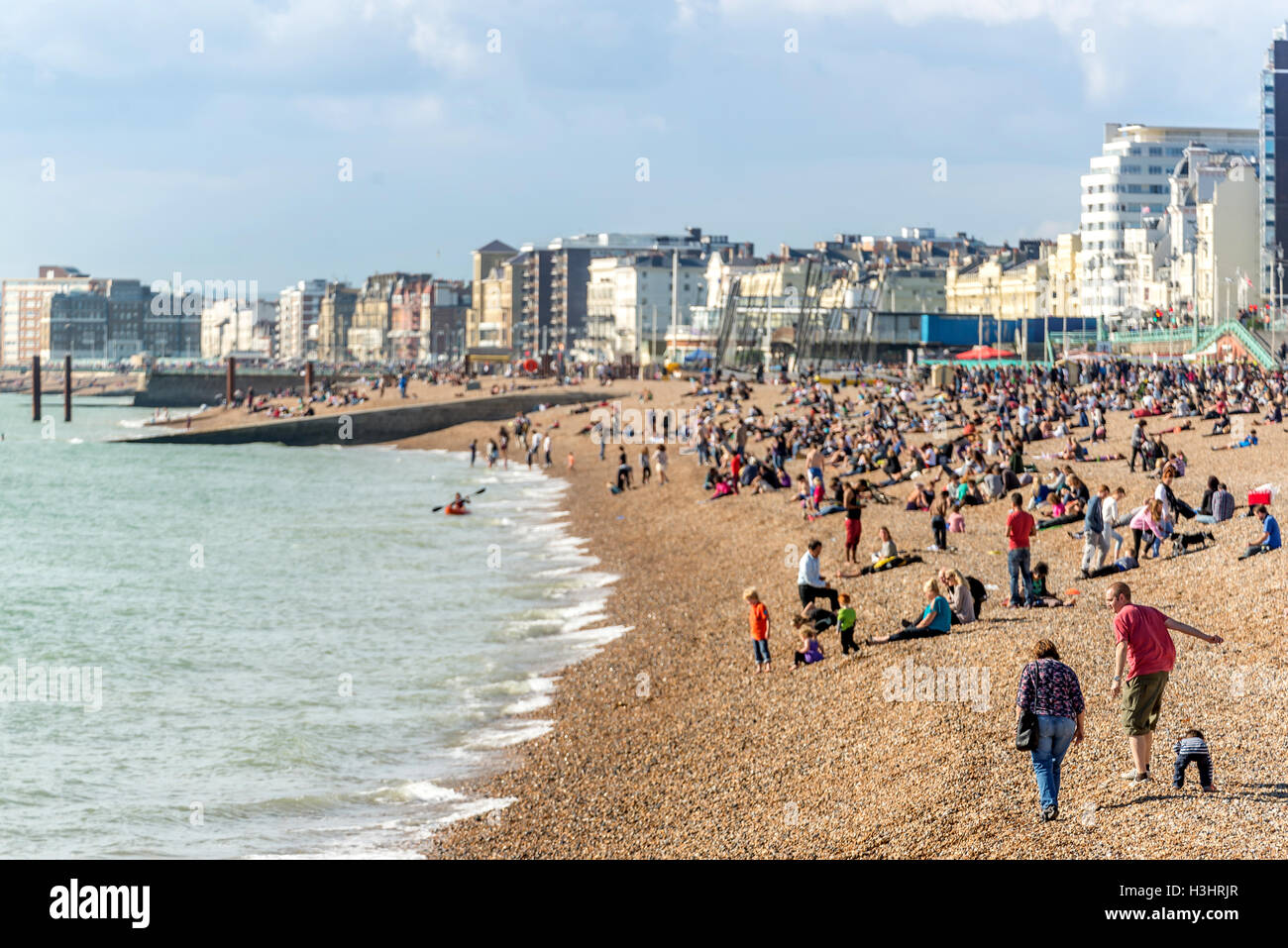Brighton beach on a warm Autumn afternoon. - Stock Image
