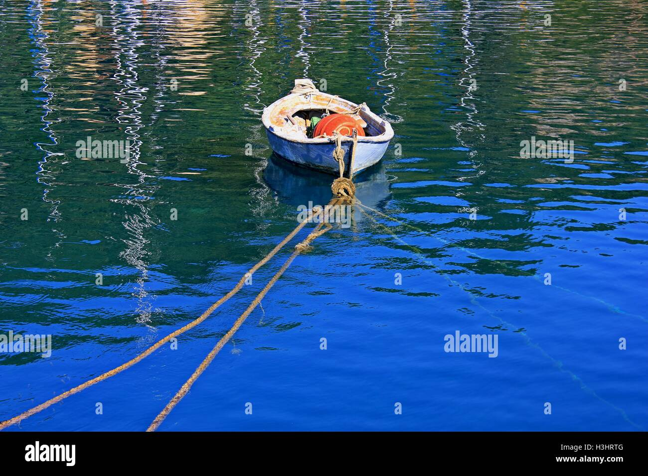 A rowing boat moored in Gaios  harbour on the isle of Paxos Greece - Stock Image