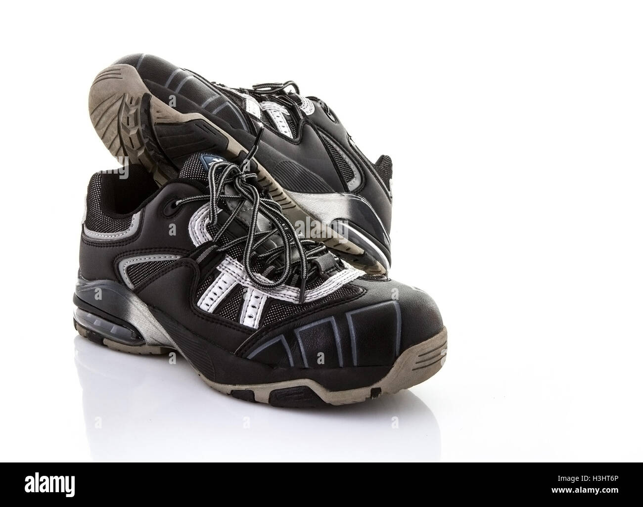 Steel Toe Cap Trainers Safety Footwear on a white background - Stock Image