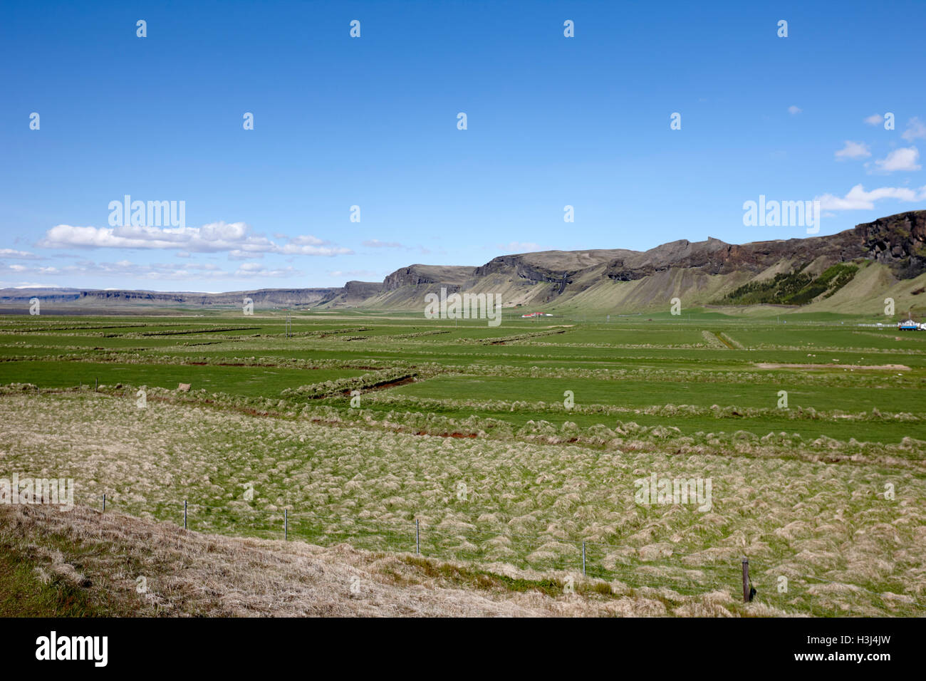 lush fertile icelandic farm and farmland with drained fields Iceland - Stock Image