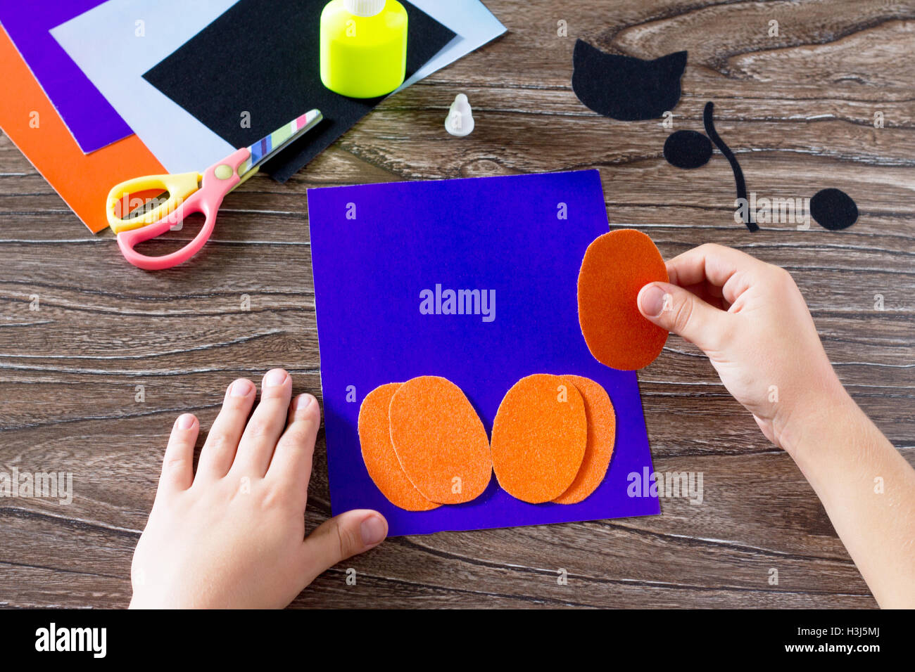 The child create a greeting card halloween paper black cat in stock the child create a greeting card halloween paper black cat in pumpkin pasting paper parts glue scissors leaves velvet paper m4hsunfo