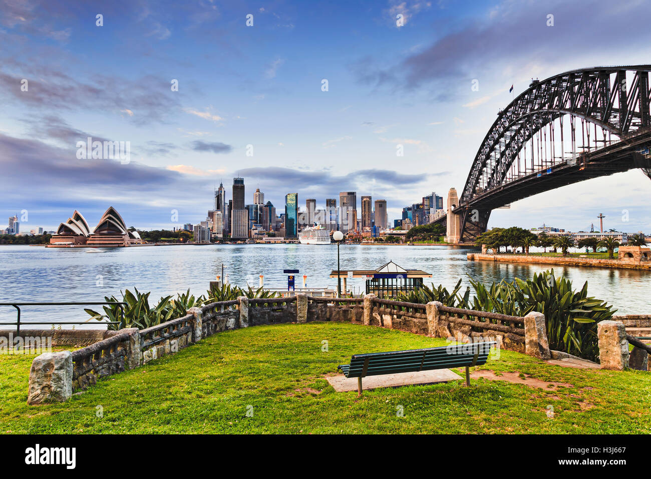 Green grass and bench in recreational park zone of Kirribilli suburb of Sydney across harbour from the city major - Stock Image