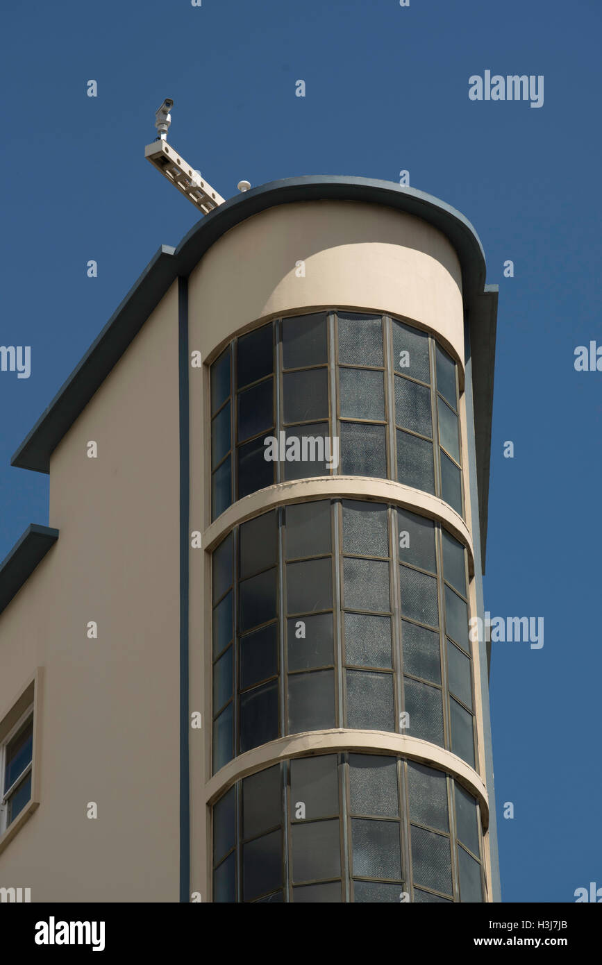 A surveillance camera mounted on the top of a tall building - Stock Image