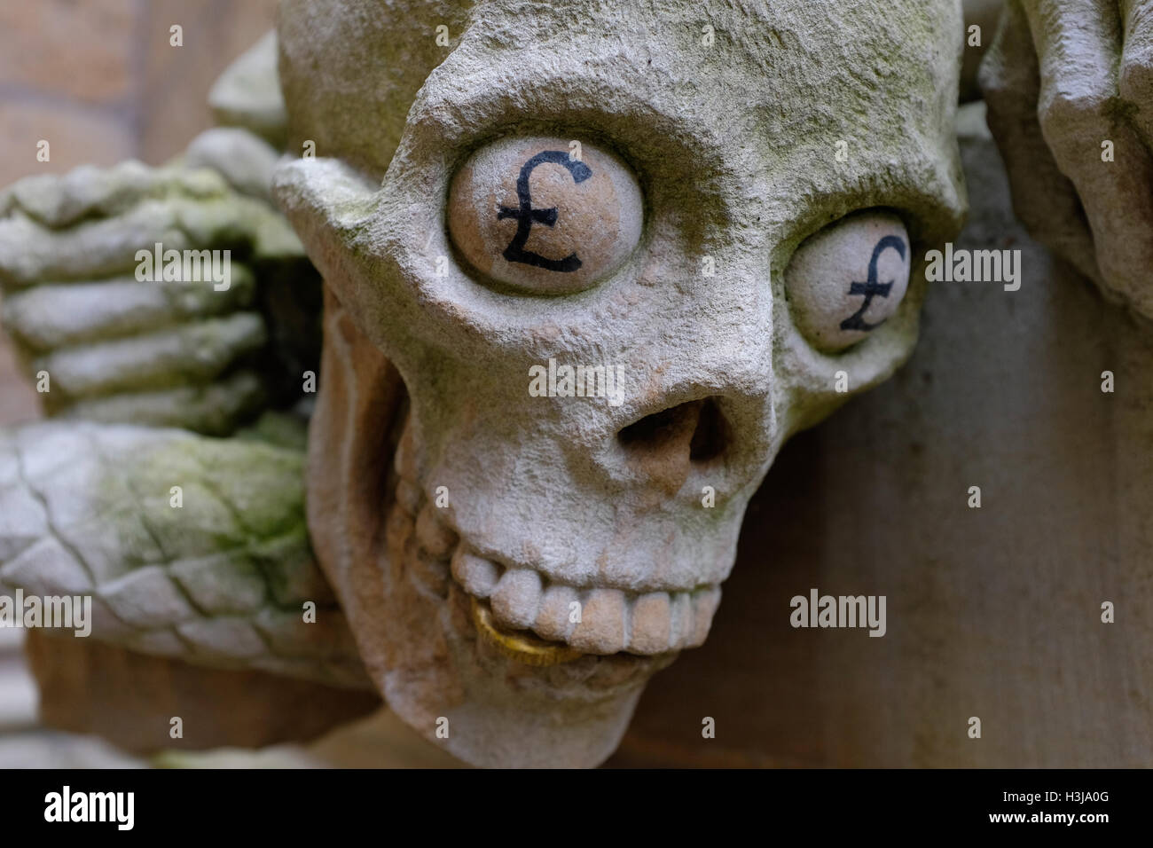 A modern grotesque (stone carving) on Lincoln Cathedral symbolising greed - Stock Image