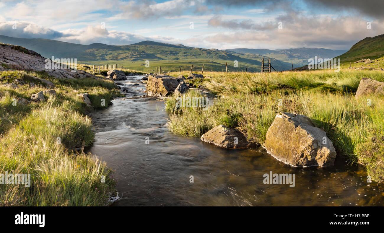 Nant Gwryd flows from Llyn Cwmffynnon leading into Dyffryn Mymbyr, Snowdonia. Stock Photo