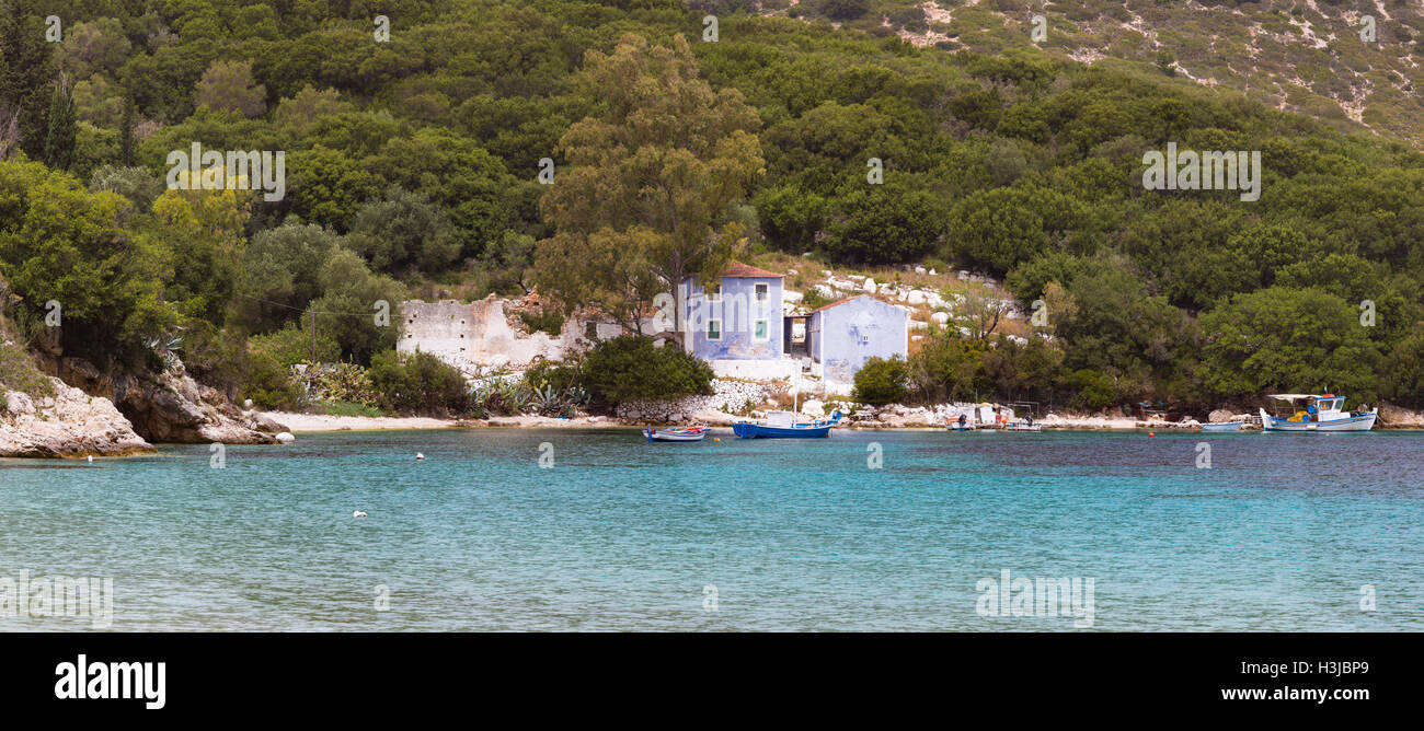 Atheras Beach, Kefalonia surrounded by a beautiful landscape of tree covered hills and sea. Stock Photo