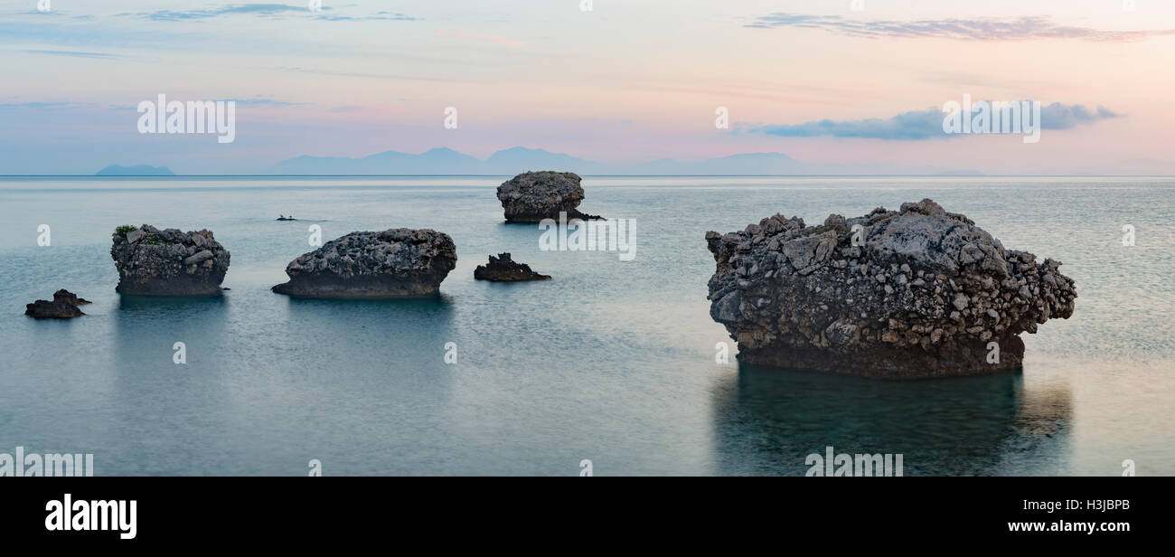 Unusual rocks stand out of the sea at Poros, Kefalonia. Stock Photo
