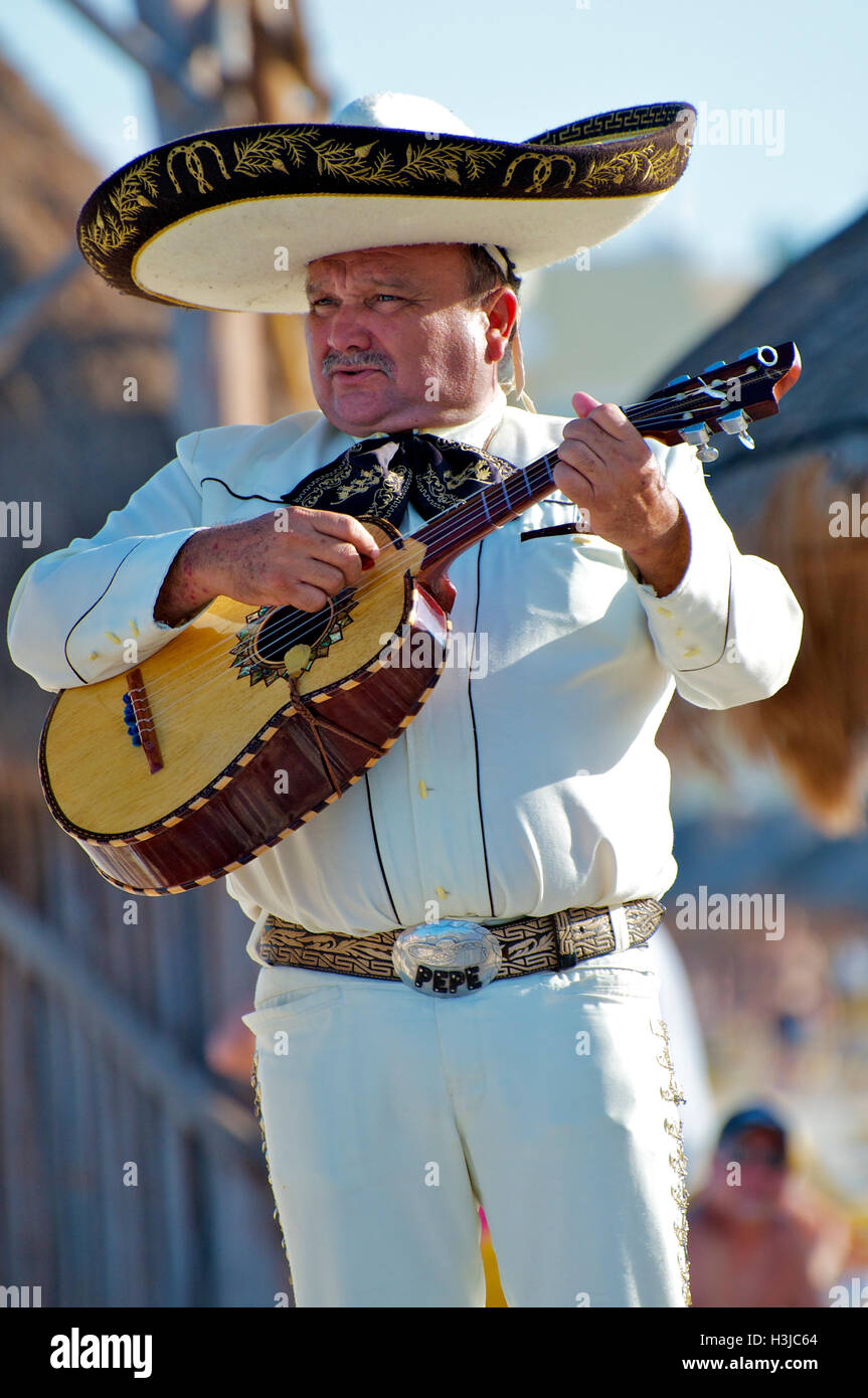Mariachi Guitar Player Performs on Sunny Beach during Wedding ...