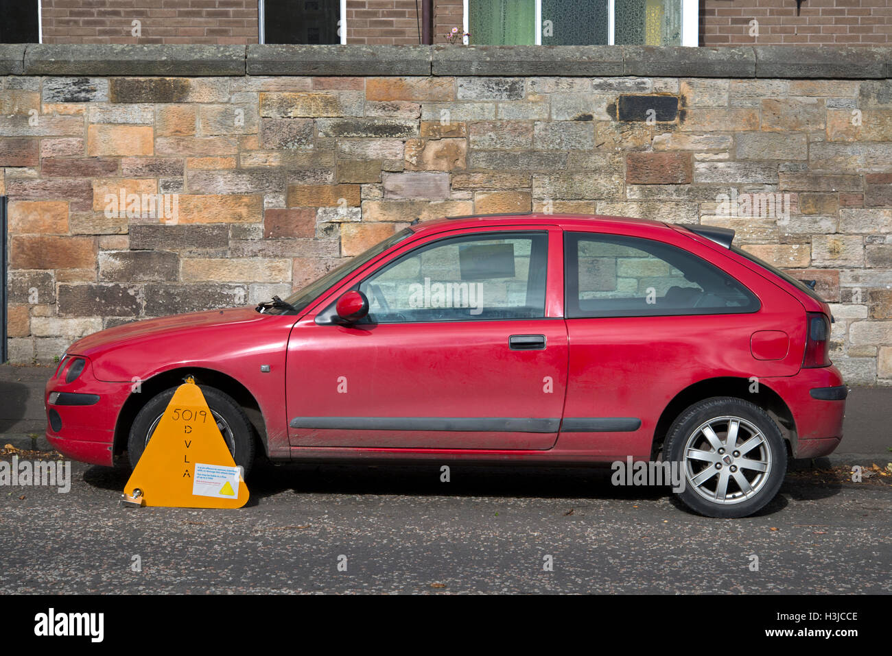 Untaxed car clamped by the DVLA. Stock Photo