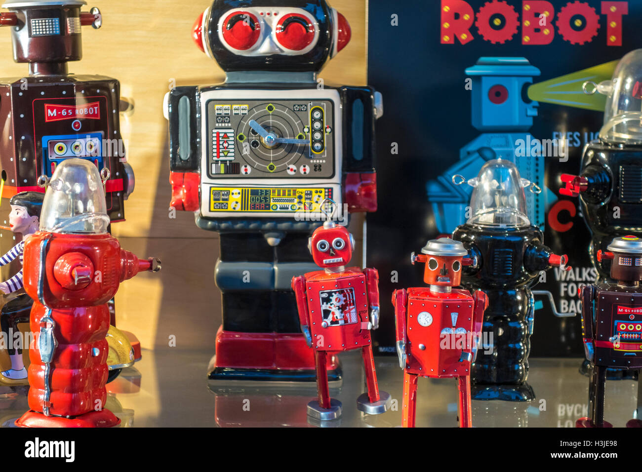 Group of Retro Robot toys. Vintage tin robots on display. - Stock Image