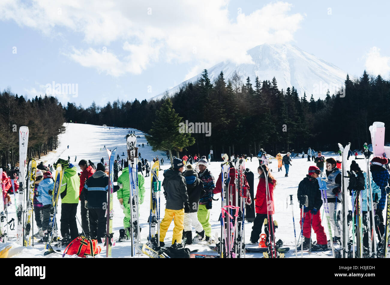 Group of skiers at the foot of mountain at a ski resort - Stock Image
