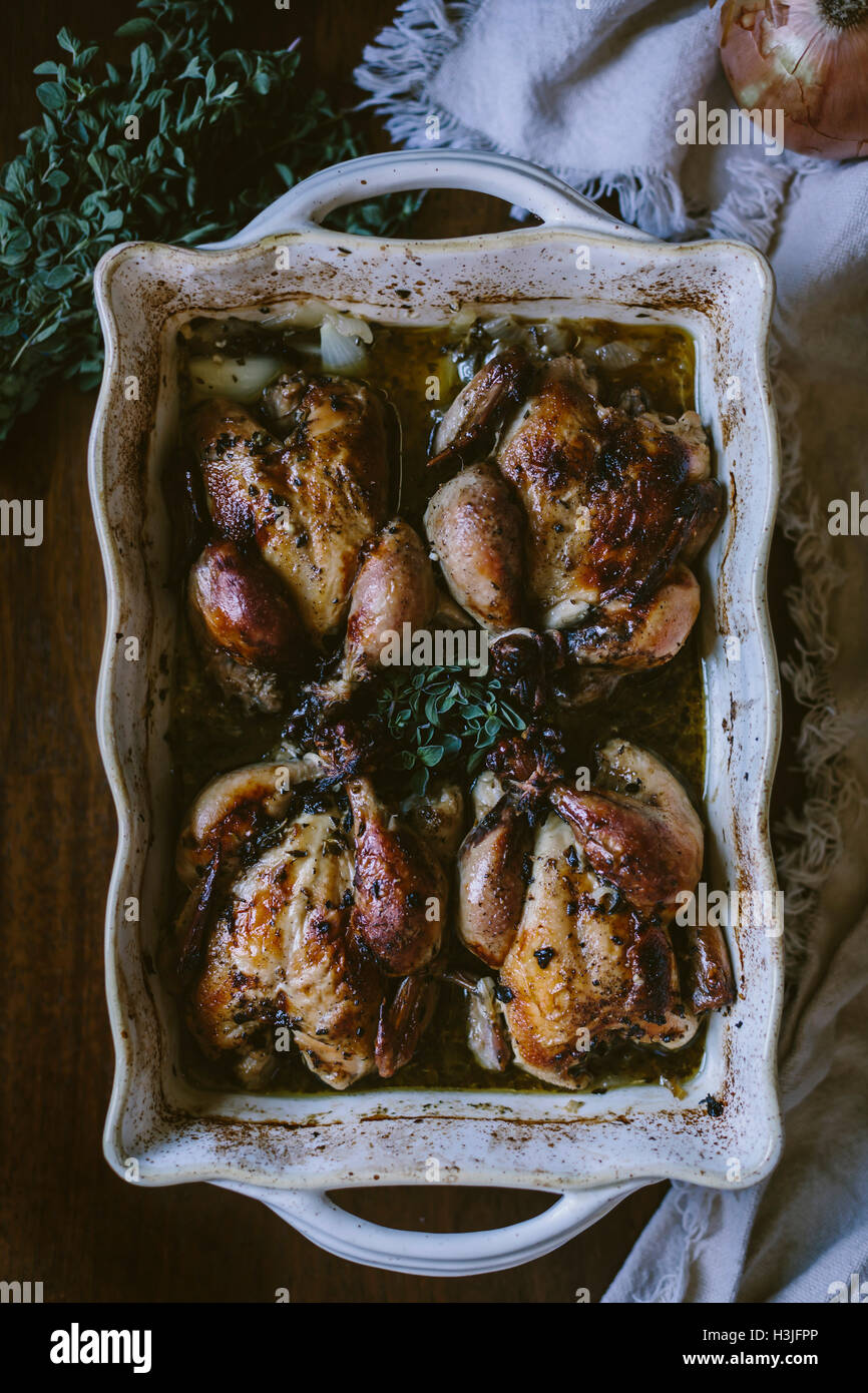 4 Cuban Roasted Game Hens are photographed right after they came out of the oven. - Stock Image