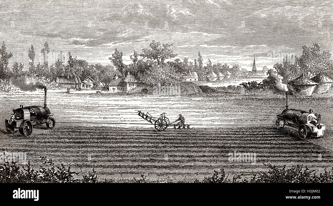 Machine steam plough systems at work, agricultural tractor powered by a steam engine, 19th Century - Stock Image