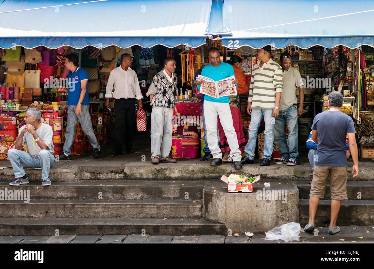 Men outside Port Louis Market Stock Photo