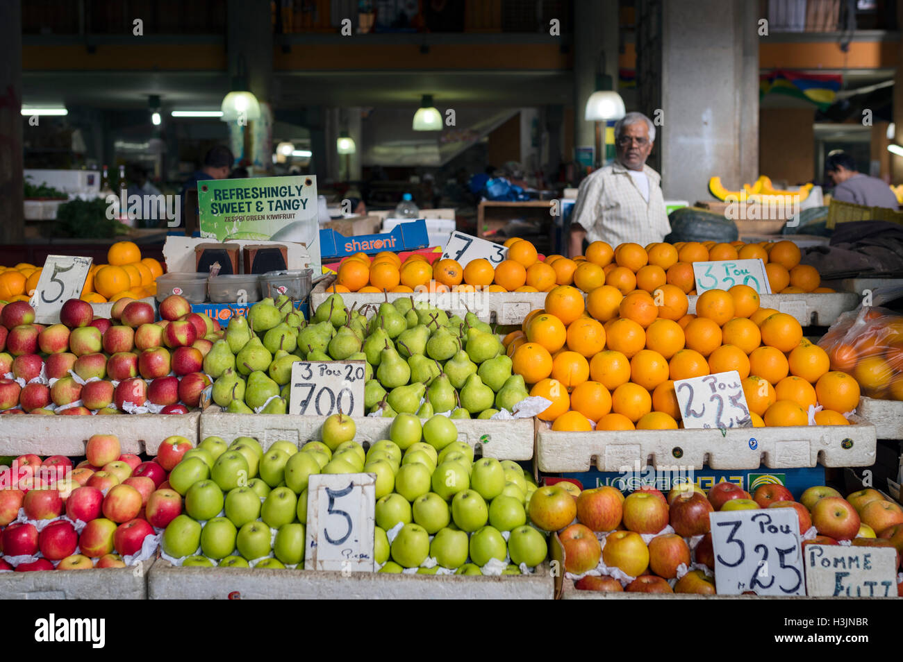 Port Louis Market fruit seller Stock Photo