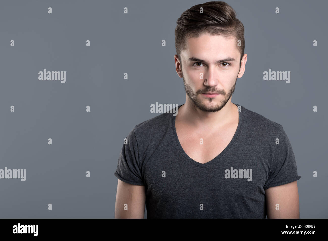 Angry bearded young man - Stock Image