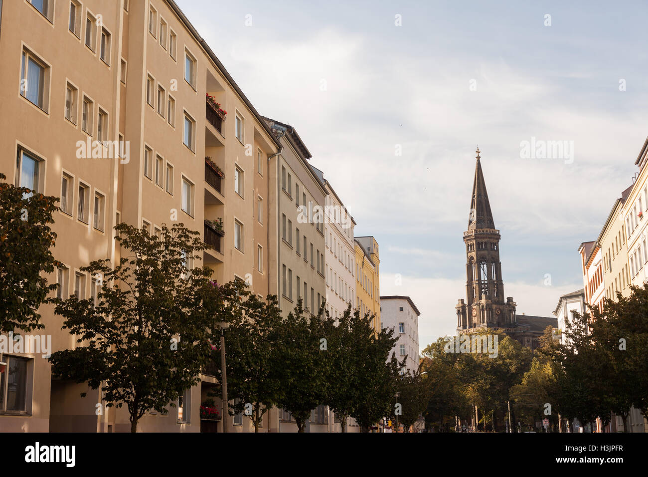 Apartments and the Zionskirche in the afternoon near Kastanienallee, Prenzlauer Berg, Berlin Stock Photo