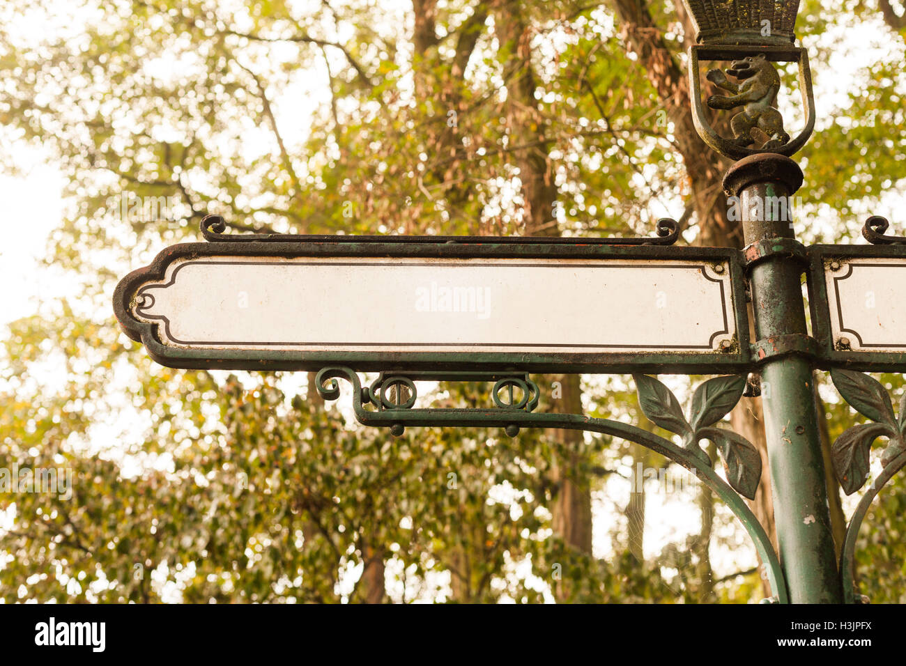 Historic street sign with trees in Berlin Stock Photo