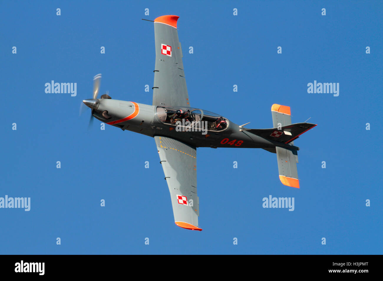 Military aviation. Polish Air Force PZL-130 Orlik turboprop trainer plane flying at an air display - Stock Image
