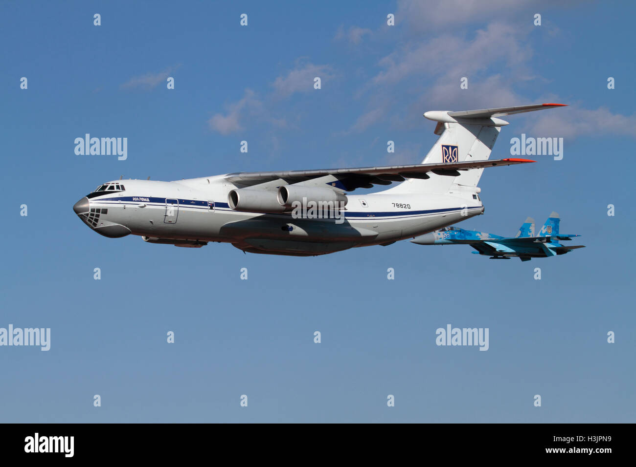 Ukraine Air Force Ilyushin Il-76 transport flying in formation with a Sukhoi Su-27 Flanker fighter jet - Stock Image