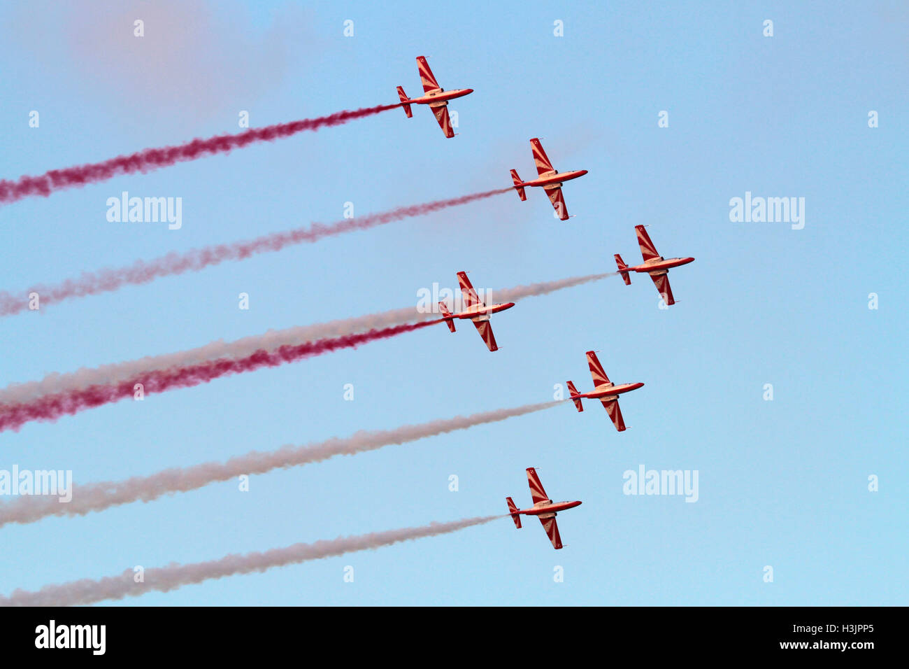The Polish Air Force aerobatic team, the Bialo-Czerwone Iskry (White and Red Sparks), flying in formation - Stock Image