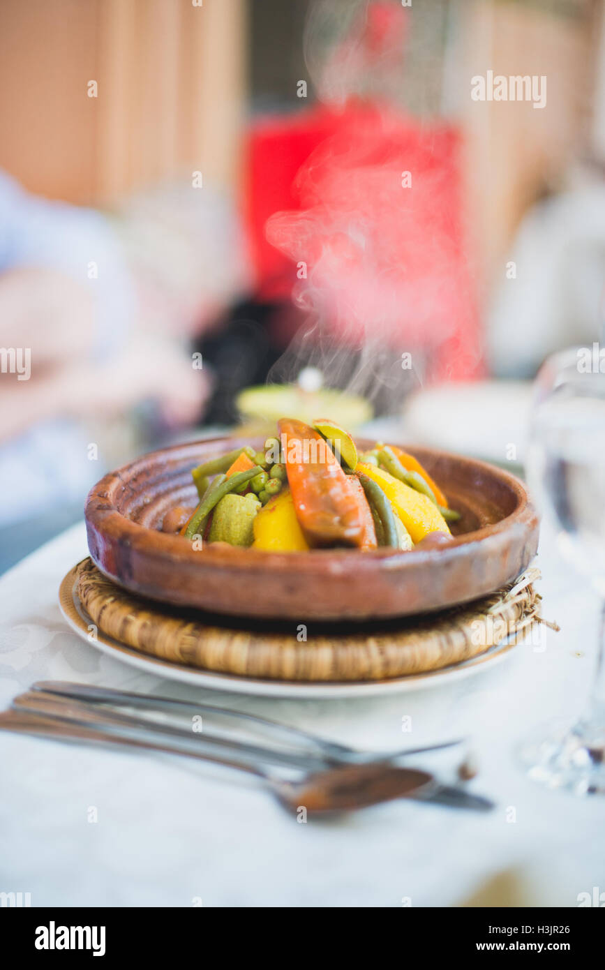 Moroccan food at The Souk market in Marrakech. Vegetable tagine, colourful & spicy ethnic meal - Stock Image