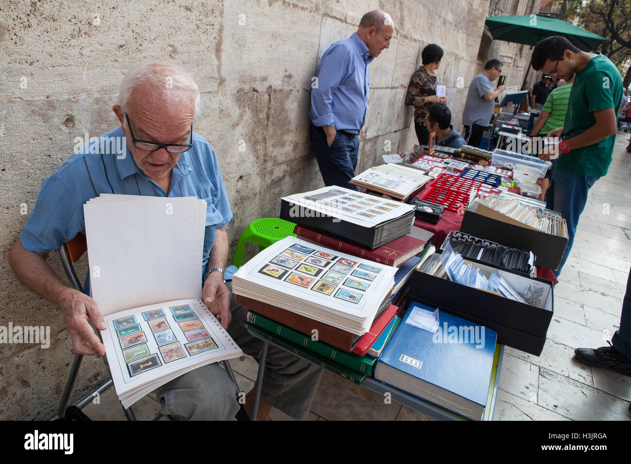 Stamp collectors at a flea market in the old quarter of Valencia - Stock Image