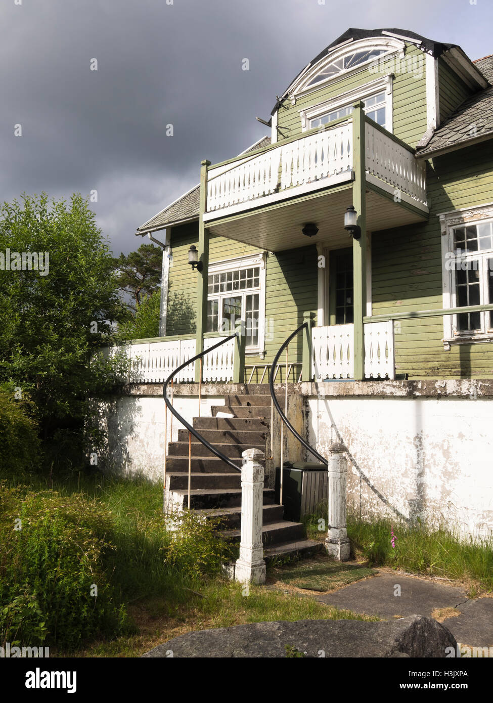 Stately old green and white clapboard villa in a state of disrepair, Utsikten, Vest-Agder Norway - Stock Image