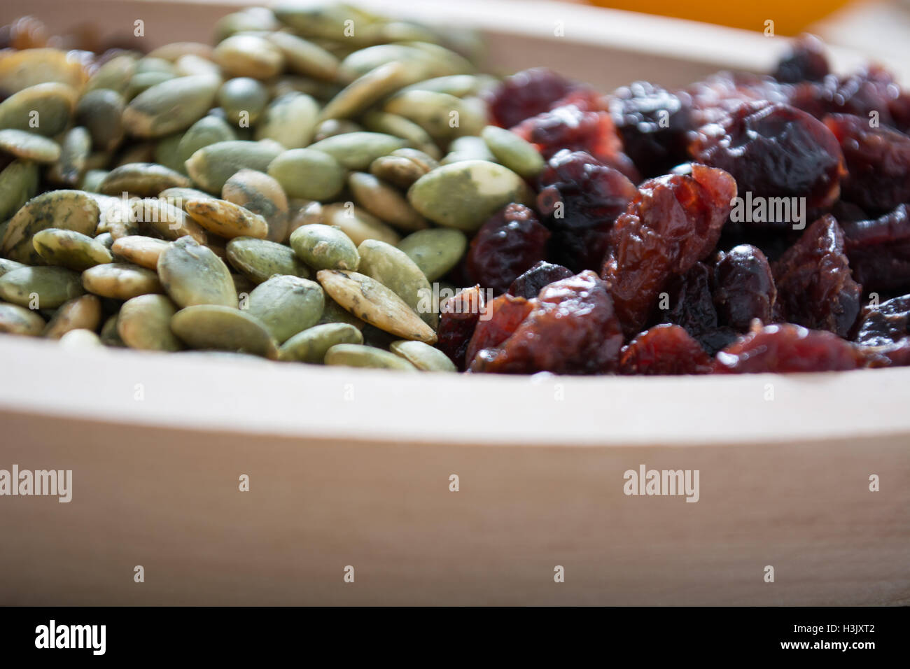 Dry fruit with pumpkin seed in the wooden bowl Stock Photo