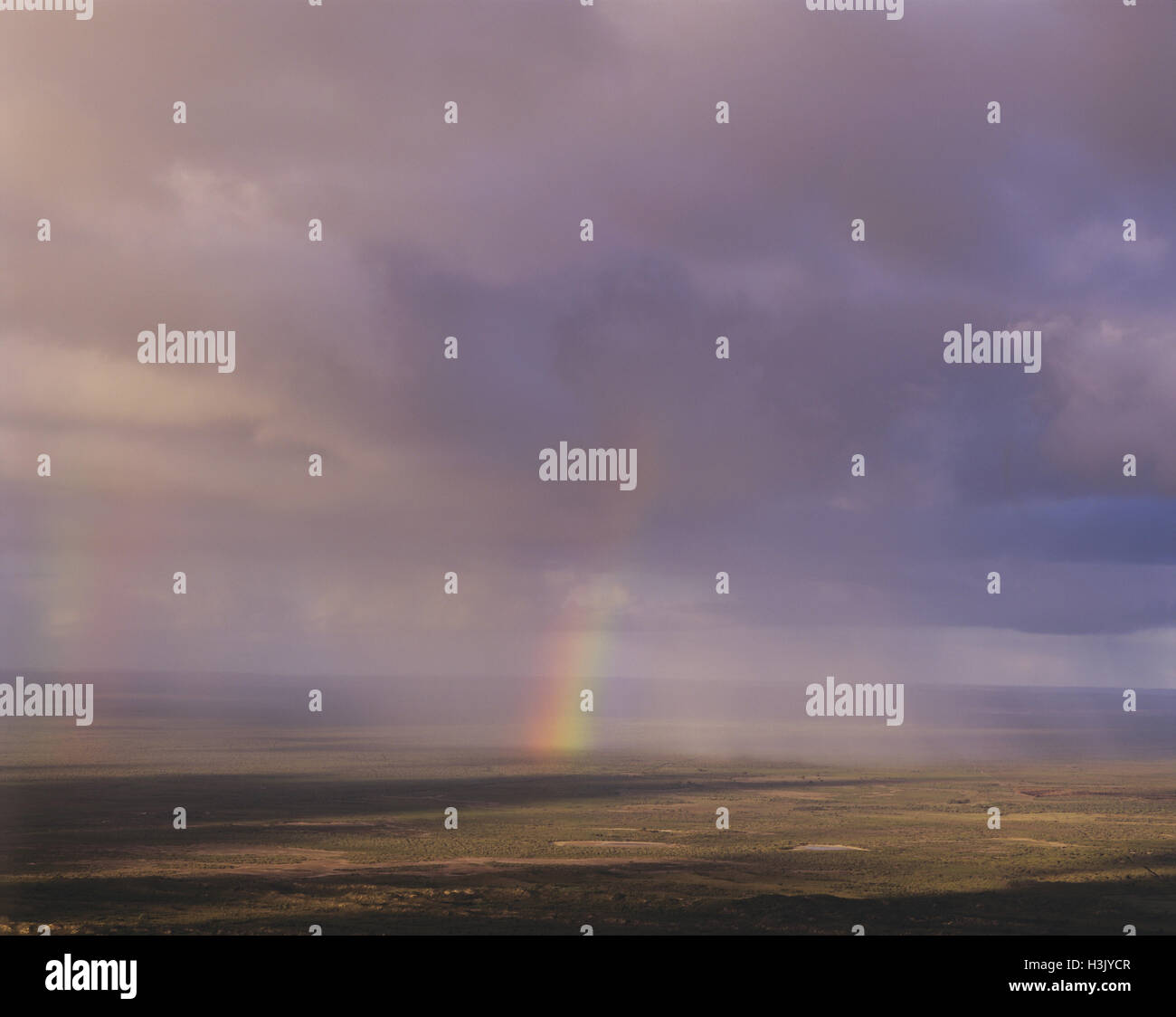 Rainbow and rain over Southern Ocean, - Stock Image
