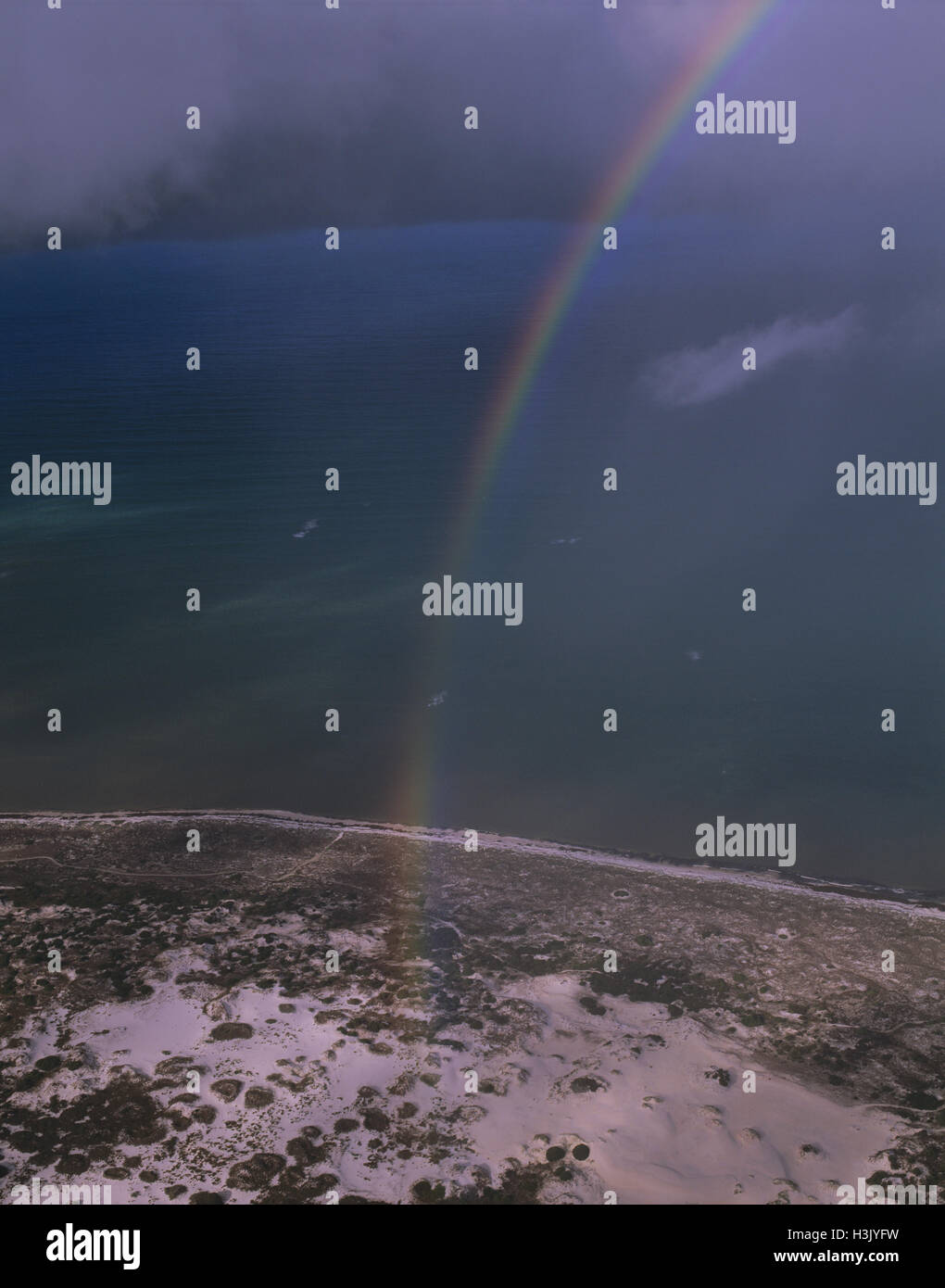 Rain storm with rainbow over the Southern Ocean, - Stock Image