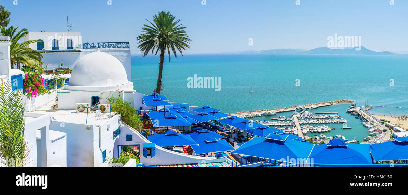 The luxury restaurants and hotels in tourist village located on the mountain top and boast the perfect views in - Stock Image