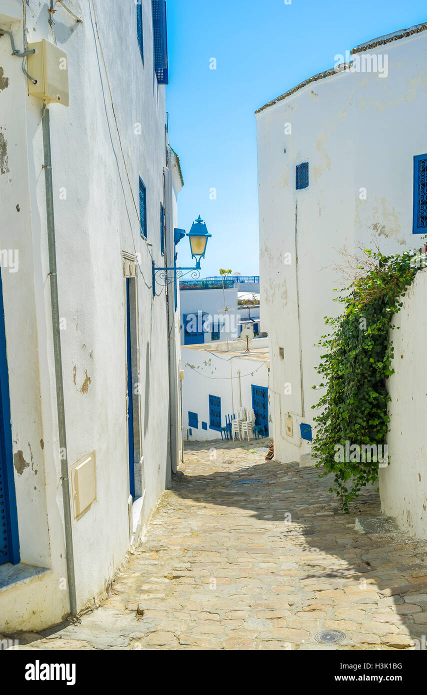 Sidi Bou Said is the hilly village, so most of its streets are climbs or descents, Tunisia. - Stock Image