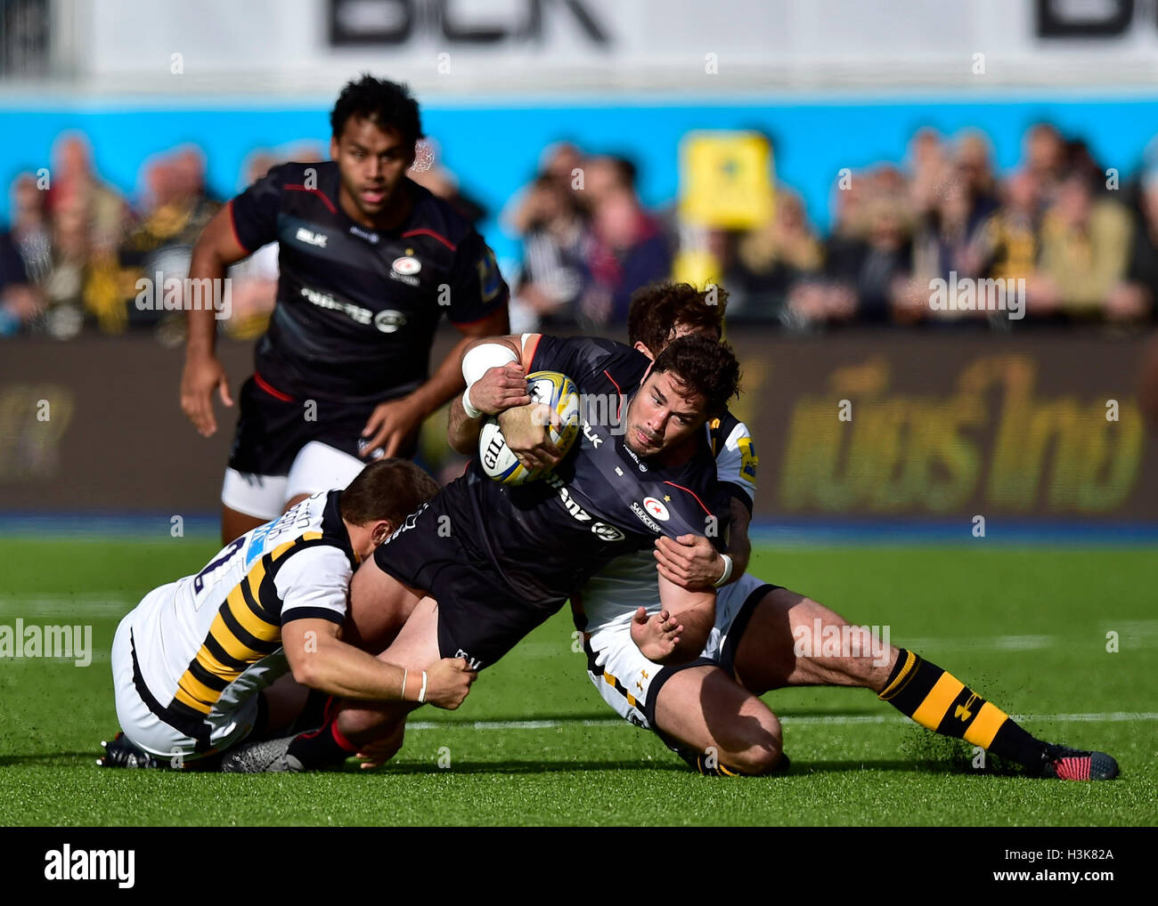 LONDON, ENGLAND - 9 October, 2016: Brad Barritt of Saracens is tackled during Aviva Premiership match between Saracens - Stock Image
